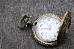 Old pocket watch. On dark gray table background Stock Photos