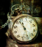 Old Pocket Watch Grungy Style. Antique pocket clock showing a few minutes to midnight grungy style. Concept of time,the past royalty free illustration