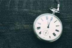 Old pocket watch with hours over time 23:55 Royalty Free Stock Image
