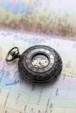 Old  pocket watch on  map Stock Image