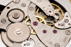 Old pocket watch mechanism. Gears and mainspring in the mechanism of a pocket watch (pocketwatch Stock Images