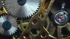 Old pocket watch movement. Macro video of an old pocket watch movement stock footage