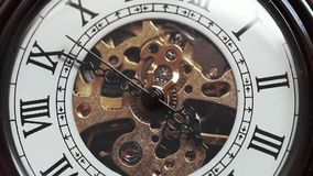 Old pocket watch movement stock footage