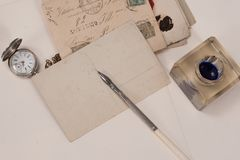 Old pocket watch, old ink pen, handwrite letters Stock Photo