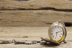 Old pocket watch on old wood background. Stock Photo