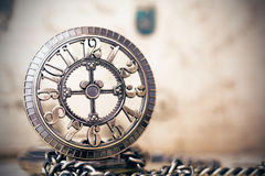 Old pocket watch over vintage map Royalty Free Stock Photo