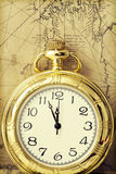 Old pocket watch over vintage map Stock Image