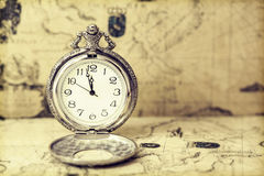 Old pocket watch over vintage map. Vintage watch on antique map. Retro still life Stock Images
