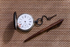 Old pocket watch and pen Royalty Free Stock Photo
