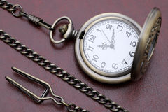 Old pocket watch. In red leather background Stock Photography