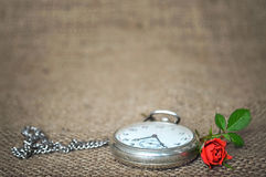 Old pocket watch and rose Stock Photo