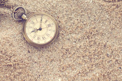 Old pocket watch in the sand Stock Photography