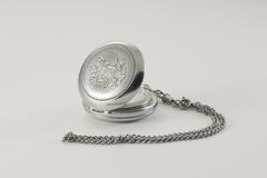 Old pocket watch. Old silver pocket watch with a two-headed eagle - Emblem of the Russian Empire Royalty Free Stock Photography