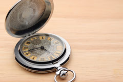 Old pocket watch. On wood background Royalty Free Stock Photo