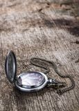 Old pocket watch on wood background Stock Photos
