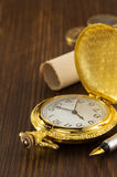 Old pocket watch on wood Royalty Free Stock Photography