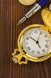 Old pocket watch on wood Royalty Free Stock Images