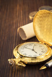 Old pocket watch on wood Stock Photography