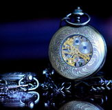Old pocket watches on a glass. Old pocket watches with ornaments on a glass table Stock Photo