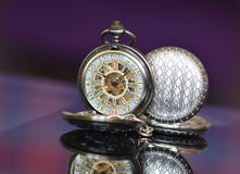 Old pocket watches. Old metalic pocket watches  on glass Royalty Free Stock Photos