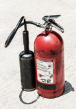 Old poertable Red fire extinguisher outdoor Stock Photos