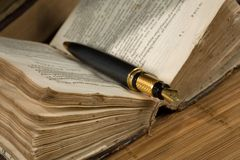 Old  poetry book and a fountain pen Stock Photography