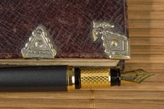 Old  poetry book and a fountain pen Royalty Free Stock Photos
