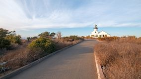HISTORIC OLD POINT LOMA LIGHTHOUSE AT CABRILLO NATIONAL MONUMENT UNDER BLUE CIRRUS CLOUD SKY AT POINT LOMA SAN DIEGO CALIFORNIA US Stock Photos