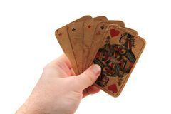 Old poker cards in my hand. Isolated on the white background stock photography