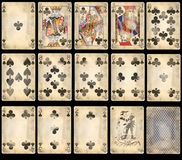 Old Poker Playing Cards - Clubs. Old classic playing cards isolated on black background: clubs suit with joker and back Stock Image