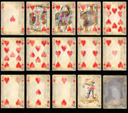 Old Poker Playing Cards - Hearts. Old classic playing cards isolated on black background: hearts suit with joker and back Stock Image
