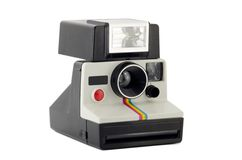 Old Polaroid Camera Isolated on White Stock Image
