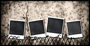 Old polaroid frames. Four old polaroid frames stuck to a fence Royalty Free Stock Photography