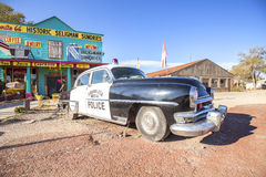 Old police car in front of historic Sundries Building. Royalty Free Stock Images