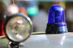 Old police light. An emergency police light at an old vw beetle Royalty Free Stock Photo
