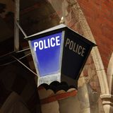 Old police station sign Stock Photos