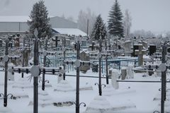 Cemetery of warriors. Old Polish cemetery with line of graves of soldiers dead in the Second World War covered under snow royalty free stock image