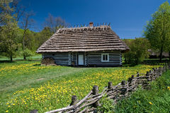Old Polish house. Very old house from Poland with thatched roof. Beautiful spring day stock photos