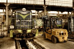 Old Polish trains in service hall Royalty Free Stock Image
