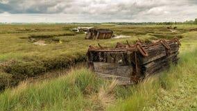 Marshland near the River Crouch, England, UK. Old pontoons in the marshland near the River Crouch, Wallasea Island, Essex, England, UK Royalty Free Stock Photos