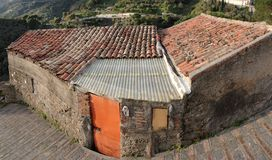 Old poor house under tile roof Stock Photography