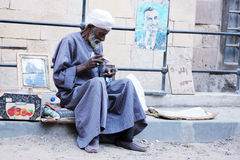 Old poor man selling fruits Stock Image