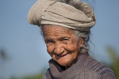 Old poor woman to Bali island. Indonesia Royalty Free Stock Images