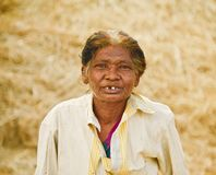 An old poor woman of Bangladesh unique portraits photo. An old poor woman wearing a shirt standing in a place unique closeup portraits photograph royalty free stock photography