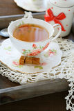 Old porcelain cup with tea Royalty Free Stock Photos