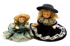Old porcelain dolls. On a white background Royalty Free Stock Photos
