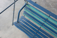 Old porch swing painted blue. Royalty Free Stock Photos