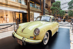 Old Porsche in The Avenues Mall, Kuwait. Old Porsche at the classic cars exhibition inside of The Avenues Mall in Kuwait. December 10, 2014 in Kuwait City Royalty Free Stock Image
