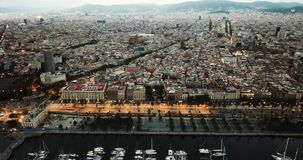 Old port in Barcelona city with of sailboats and yachts and historical part of the city at night. Aerial view of old port in Barcelona city with of sailboats and stock footage
