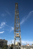 Old port cargo crane over blue sky Valencia harbor Royalty Free Stock Images